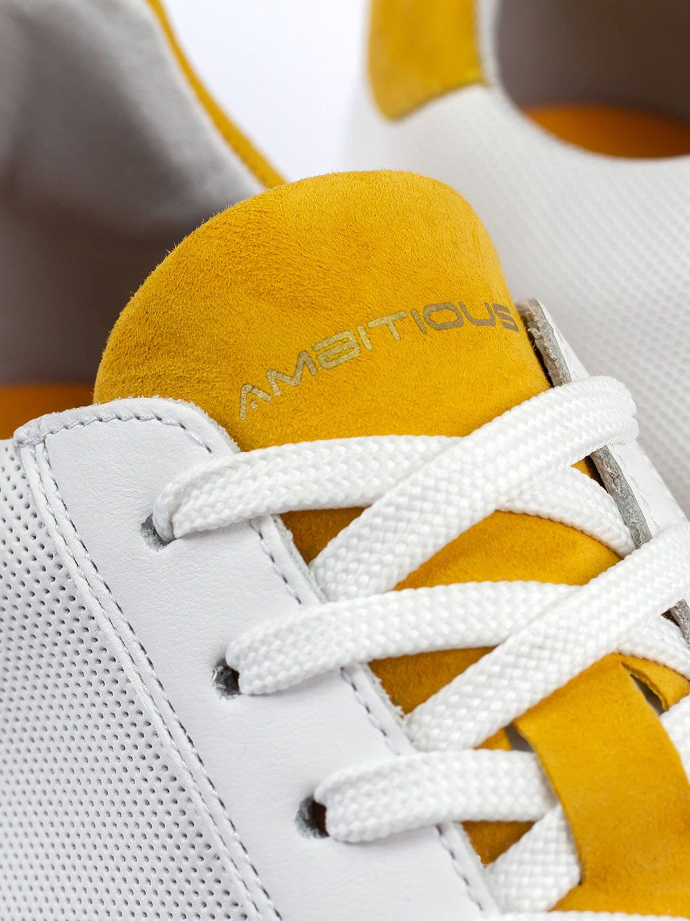 White Sneakers Yellow Detail   AMBITIOUS