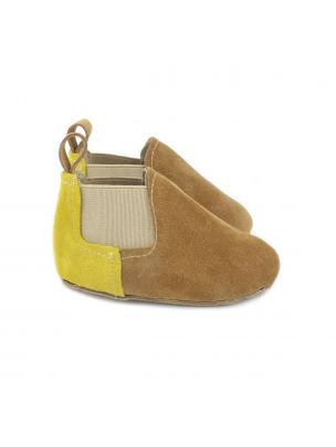 Baby boots in camel suede with mustard yellow panel on the heel.