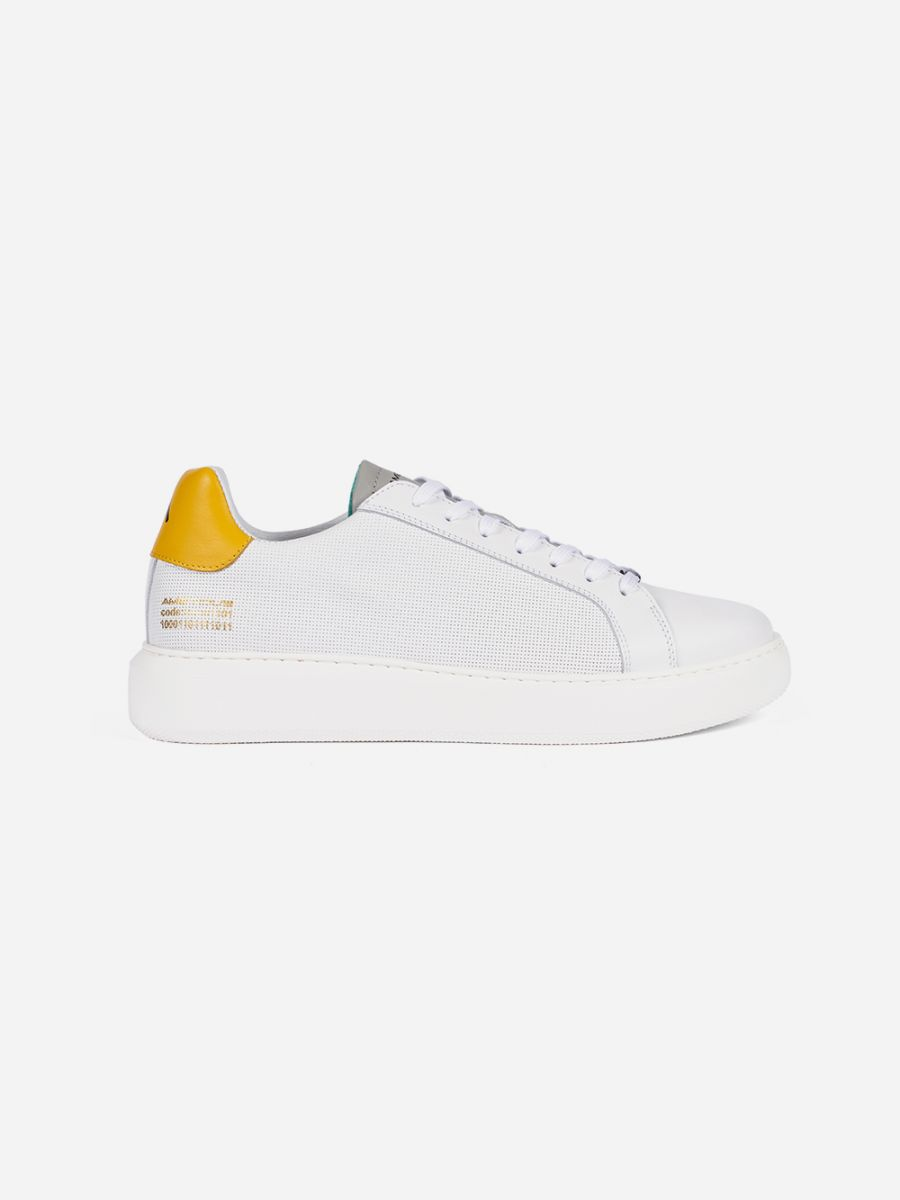 White and yellow sneakers